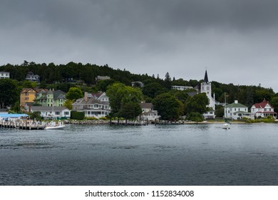 Mackinac Island Harbor with calm water and cloudy sky