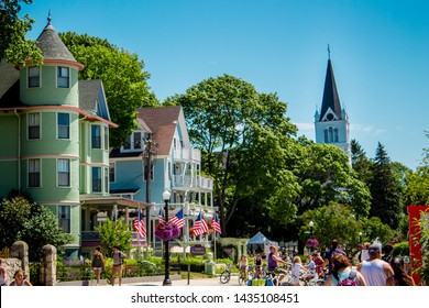 Mackinac Island, MI / USA - July 9th 2016: Sainte Anne's church peaking up over the tree line from downtown Mackinac Island Michigan