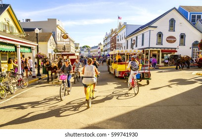 Mackinac Island, Michigan, August 8, 2016: Vacationers take on Market Street on Mackinac Island that is lined with shops and restaurants. No motorized vehicles are allowed on the island.