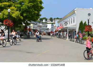 Mackinac Island, Michigan, USA, August 16, 2018: View of the city central street at tourist season