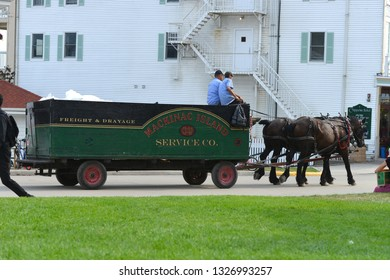 Mackinac Island, Michigan, USA, August 16, 2018: View of the city central street at horse cart service