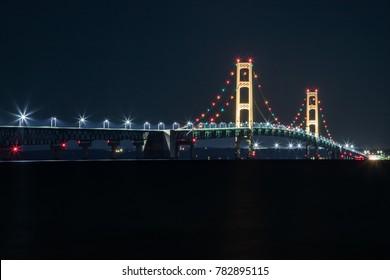 Mackinaw City, MI / USA - September 9, 2017: The historic Mackinaw Bridge at night.