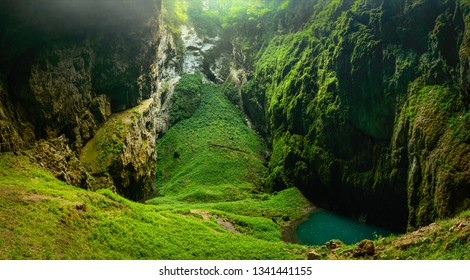 Macocha Abyss, Moravian Karst microclimate with juicy greenery and a small lake.