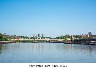 The Macombs Dam Bridge is a swing bridge over the Harlem River,connecting the boroughs of Manhattan and Bronx near Yankee Stadium. The bridge was designated a New York City Landmark in 1992.