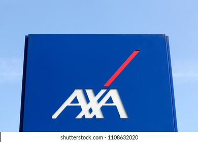 Macon, France - March 22, 2016: AXA insurance logo on a panel. AXA is a French multinational insurance firm that engages in global insurance, investment management and financial services