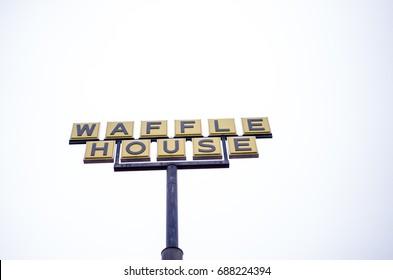 MACON, GA Dec 15, 2014: Sign for Waffle House restaurant on a cloudy overcast day