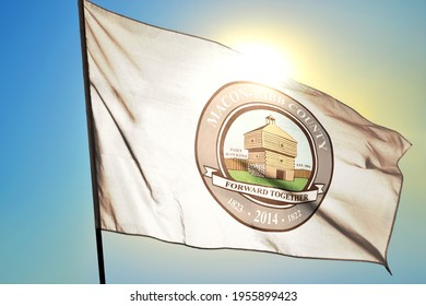 Macon Macon-Bibb county of Georgia of United States flag waving on the wind in front of sun