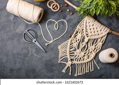 Macrame, handmade macrame for home decoration, creative hobby layout with accessories, top view