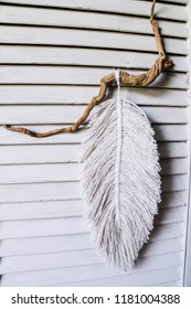 macrame, lace on the wooden background. dream catcher, shabby chic, copy space.