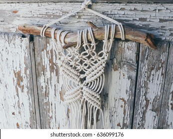macrame, lace on the wooden background