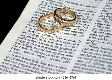 Macro of 1 Corinthians 13:4 Love is Patient with Wedding Bands