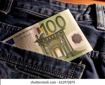 macro 100 euro banknote in jeans pocket