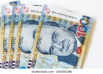 Macro of 100 Peruvian soles bills placed in fan on white background viewed from above