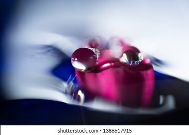 Macro, abstract composition with colorful water drops on a petal
