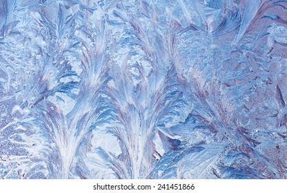 Macro of abstract frost pattern on window.