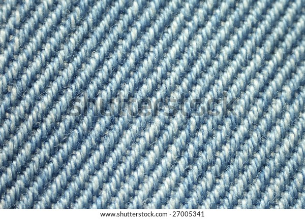 Macro of actual blue cotton denim fabric.
