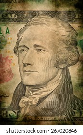 Macro of Alexander Hamilton on ten USA one dollar banknote grunge vintage style