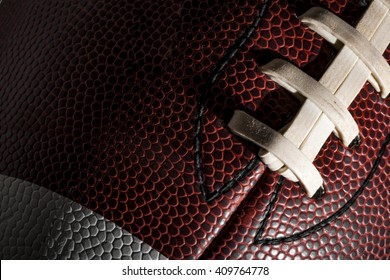 Macro of a american football ball with visible laces, stitches and pigskin pattern
