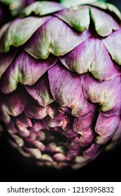 Macro background with roman artichokes on a dark background. Italian food ingredients