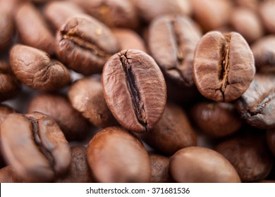 Macro bean coffee on the coffee beans background. Studio shot. Strong black espresso beans.