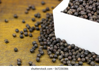 Macro Black Whole Pepper on Natural color background