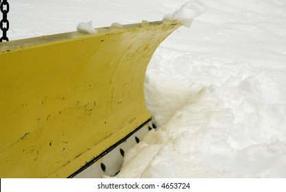 a macro of a blade on a snow plow truck