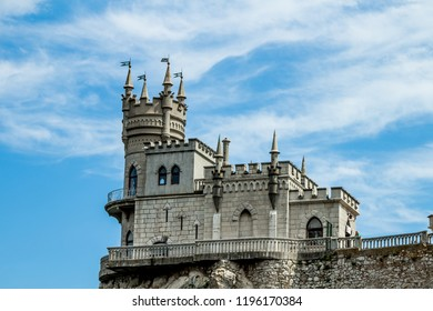 Macro of the castle Swallow's Nest on a rock at the Black Sea, Crimea with unclouded sky background. Architecture and nature of Crimea