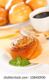 Macro of cinnamon roll breakfast along sweet cakes and coffee
