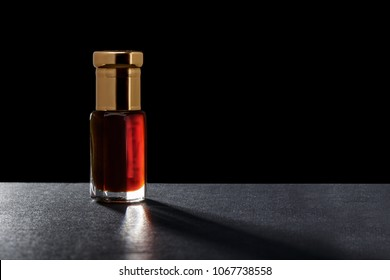 Macro Close Up Of Aromatic Essential Oil Serum In A Crystal Glass Bottle Natural Premium Scented Oil Perfume Isolated On Black Background
