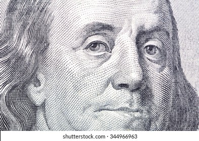 Macro close up of Ben Franklin's face on the US $100 dollar bill