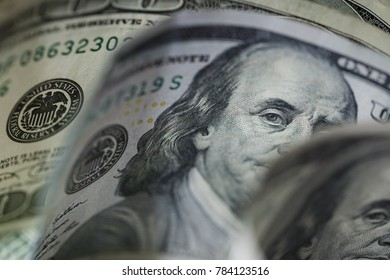 Macro close up of Ben Franklin's face on the US 100 dollar bill.