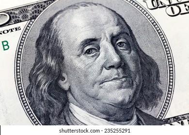 Macro close up of Benjamin Franklin's face on the US $100 dollar bill