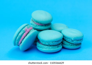 Macro close up of blue macaron cookie on blue backgrounds