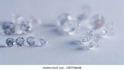 Macro close up of experienced goldsmith sorting high quality diamonds, selecting them to make precious jewels in workshop.Concept of jewelry,luxury,goldsmith, diamonds, brilliance.