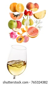 Macro close up of glass with white wine.Conceptual fruit and flower aromas floating above white wine glass.Isolated on white background.