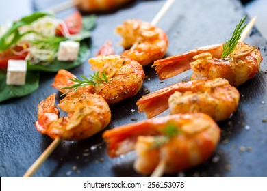 Macro close up of hot spicy char grilled queen prawn brochettes.