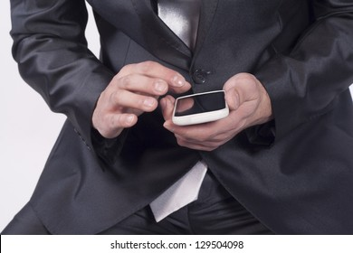 Macro close up of male hand reviewing business information on smart phone.