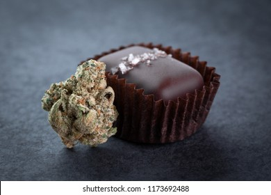 Macro close up on a marijuana bud beside a pot infused salted caramel edible
