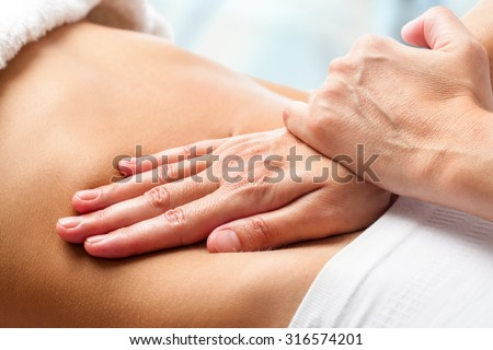 Macro close up of Osteopathic belly massage.