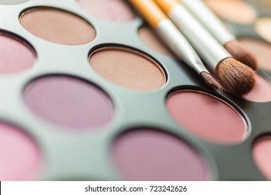 Macro close up photograph of make up or makeup pallet or palette and brushes