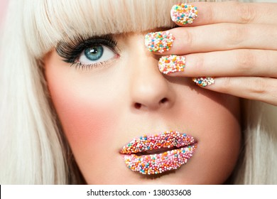 Macro close up portrait of young blond woman with fantasy make up.