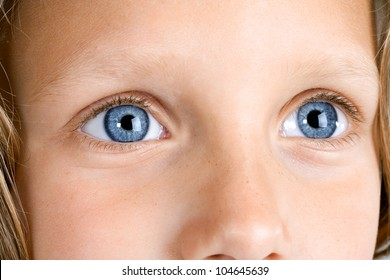 Macro Close up portrait of young girls blue eyes.