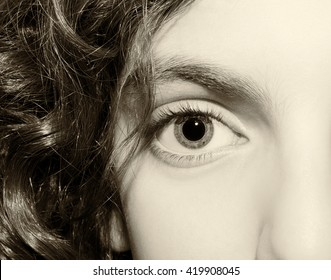 Macro Close up portrait of young girls vintage eyes.