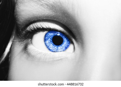 Macro Close up portrait of young girls blue eye