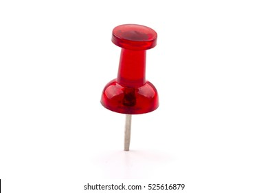 Macro close up of Red Push Pin isolated on white background.