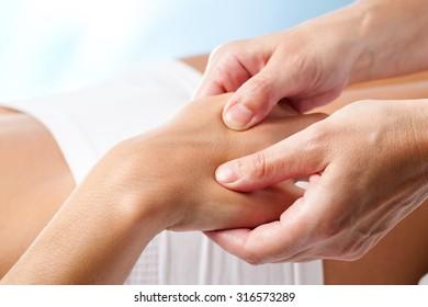 Macro close up of Therapeutic hand massage.