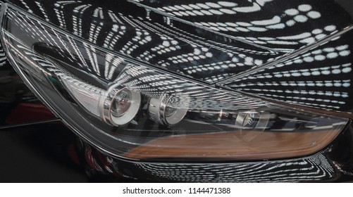The macro close up view of luxurious car headlights