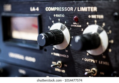 Macro close up of vintage sound studio effect equipment control panel knobs and levels short depth of field selective focus