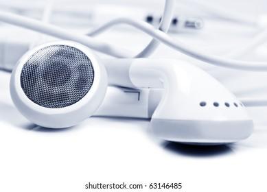 Macro close up of white earphones - very shallow depth field
