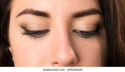 Macro - Close up of woman eyes looking down